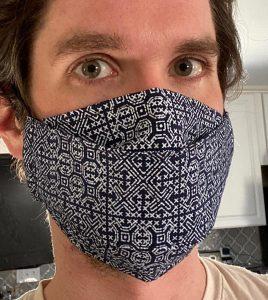 Origami face mask. Batik worn view.