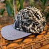 Black Seas 6-panel hat by The Ampal Creative. Side view.