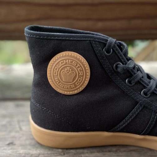 Colchester Rubber Co. National Treasure Black Gum High Top Sneakers. Logo view.