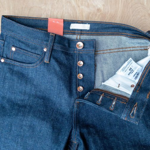 Unbranded UB101 skinny fit 14.5 oz. indigo selvedge jeans. Button fly view.