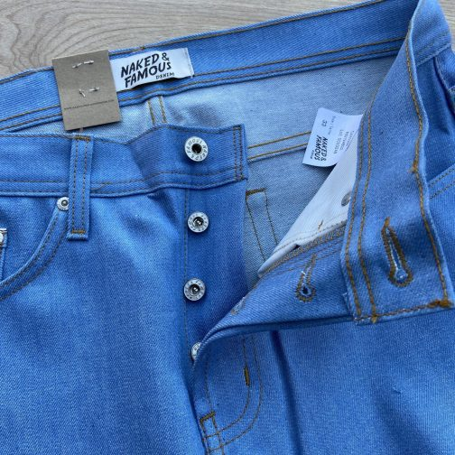 Summer Sky Selvedge by Naked and Famous Denim. Back top block view. Button fly view.
