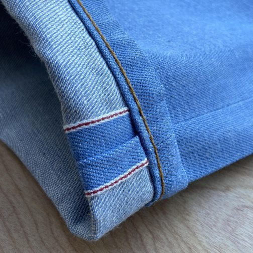 Summer Sky Selvedge by Naked and Famous Denim. Back top block view. Selvedge ID view.